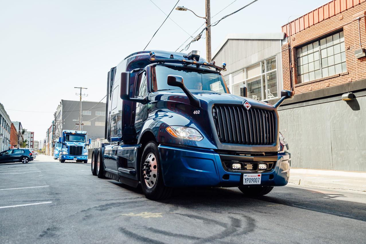 Photo of Embark trucks on side street.